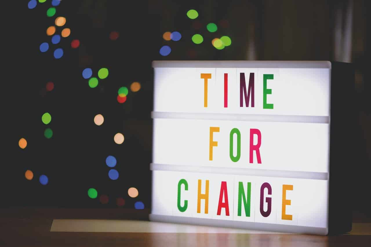 A sign reads 'Time for Change'