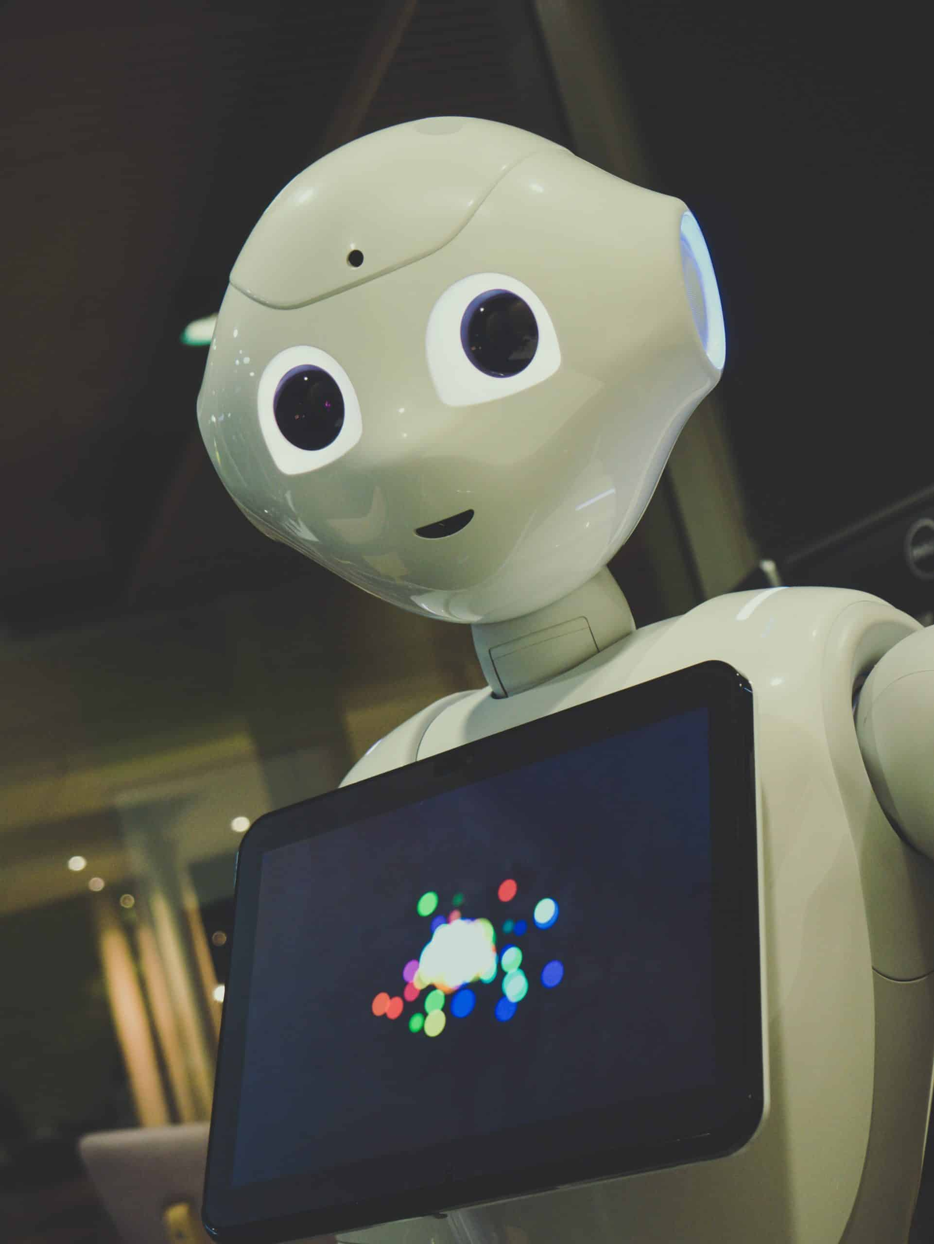 A robot with a touch screen interface on its chest. This symbolizes the future of work.