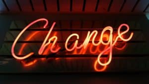 A neon sign that displays the word 'Change'.