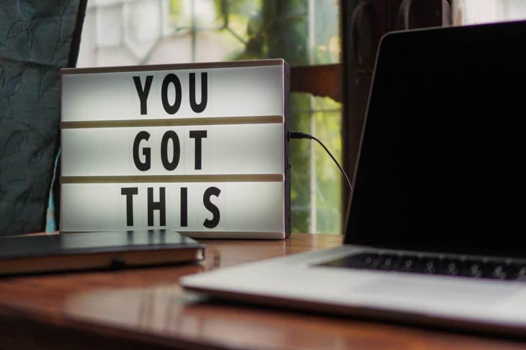 remote work laptop encouraging sign