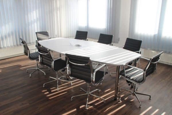 This is an empty boardroom, acting as a metaphor for a virtual board meeting.