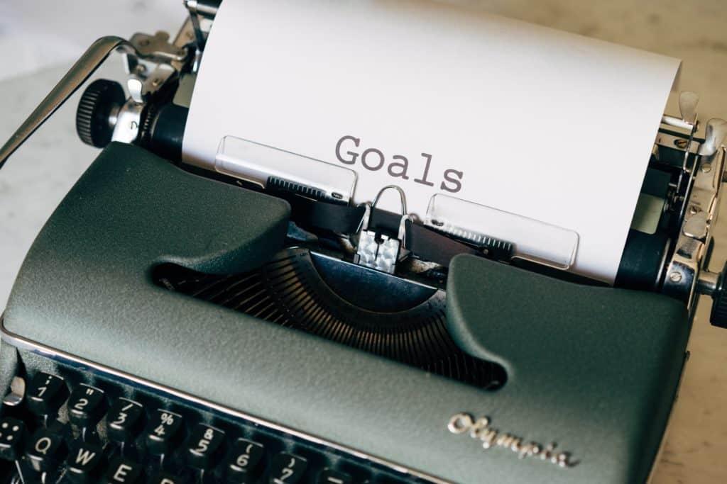 typewriter with goals written