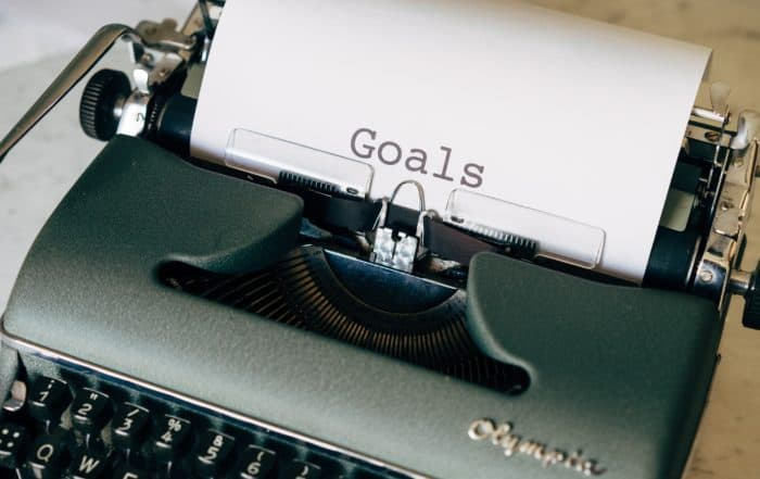 typewriter with goals written