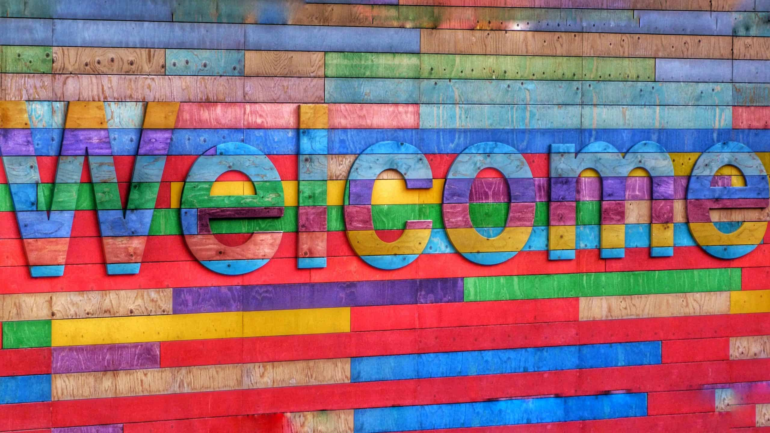 brightly colored welcome sign